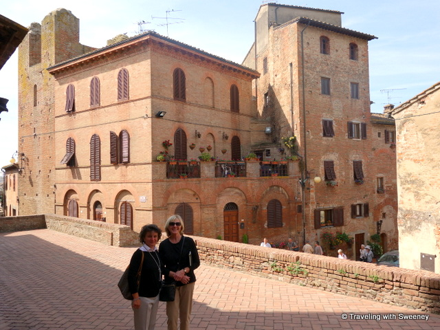 the terrace of Palazzo Pretorio, typical Certaldo Alta buildings in the background