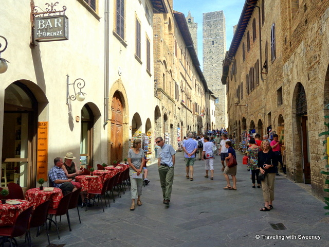 Via San Giovanni (in background) is Torre Grossa (left) and Torre Becci (right)