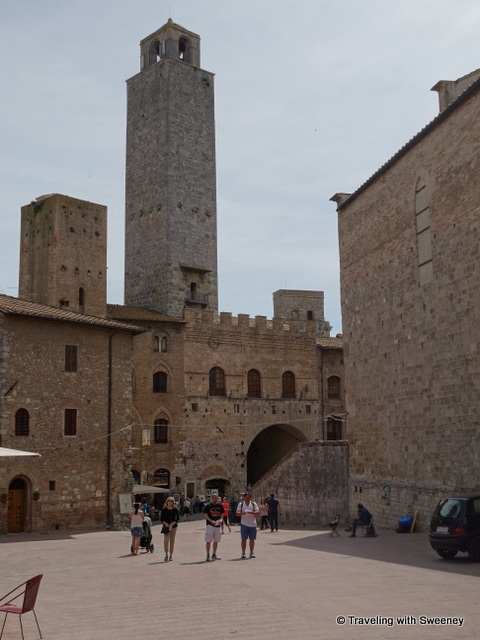 Torre Rognosa rising above the Palazzo Comunale on Piazza del Duomo with Torre Chigi, the lower tower on its left