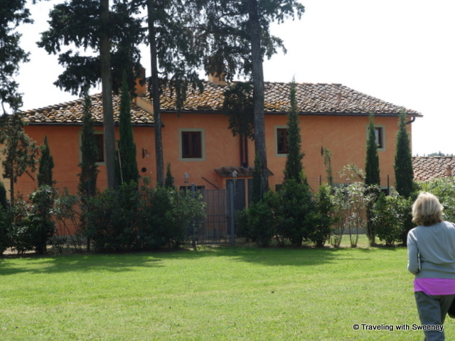 Crossing the wide expanse of lawn to the Borgorosa holiday rental buildings from the family villa