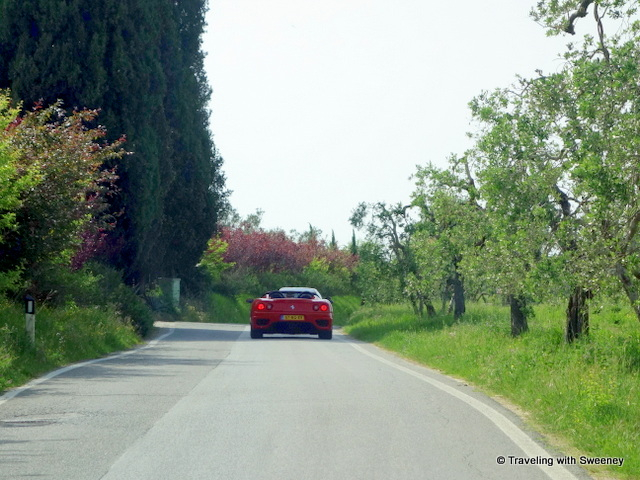 Ferrari-spotting on the country road in the Chianti hills of Tuscany