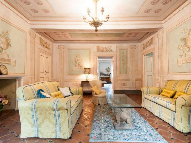 Elegant decor and beautiful frescoes in first floor living room of Villa Sant'Andrea