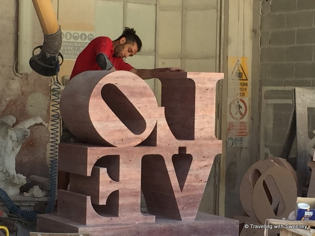 LOVE sculpture in a Pietrasanta marble workshop