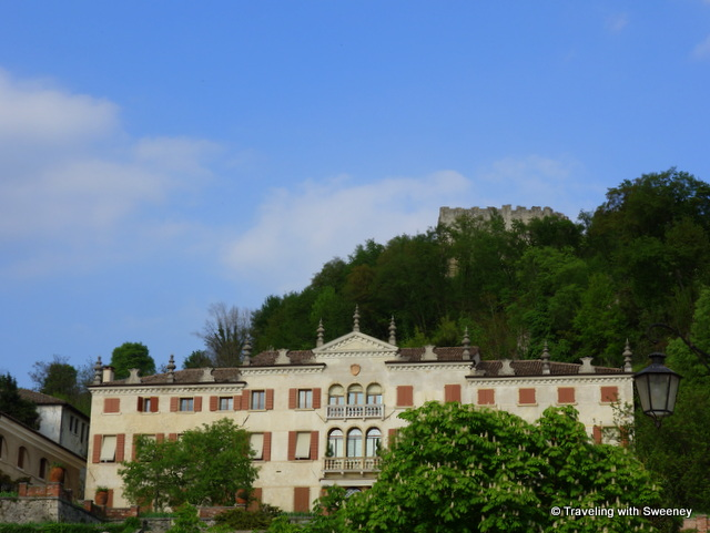 Above the trees — La Rocca atop Mount Ricco seen from Piazza Garibaldi