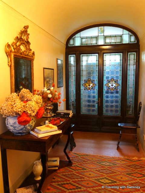 Art, books, and fine decor in the entrance of Villa Collina